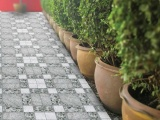 Why Your Outdoor Living Areas Might Benefit From Tiles